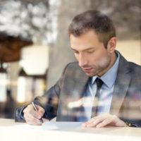 Businessman reading agreement