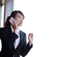 Young business woman using smart phone